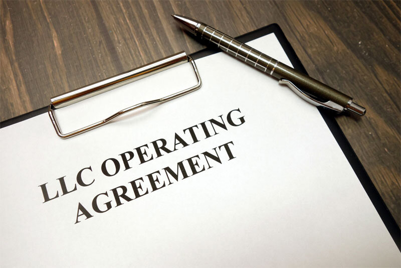 LLC Operating Agreement Document and Pen