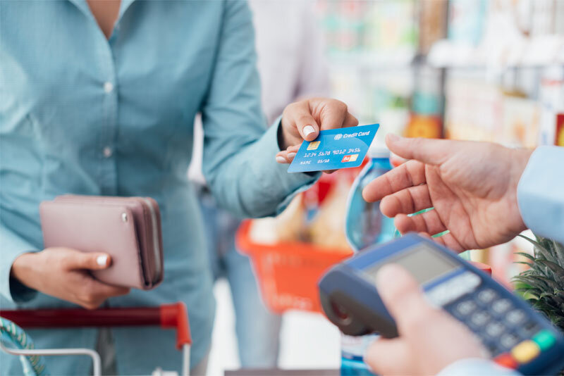 Woman at Store Checkout with Credit Card