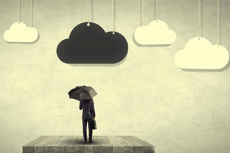 Businessman Under Black Cloud