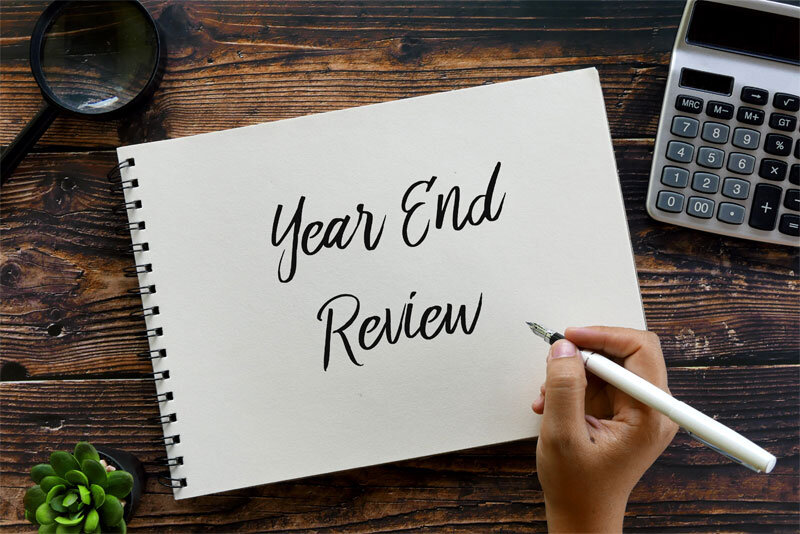 Year End Review Written on Pad