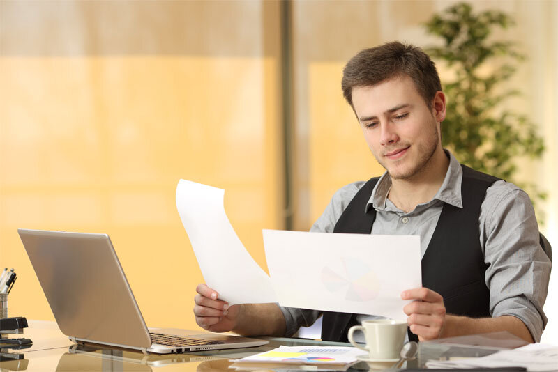 Man Reviewing Documents